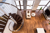Curve stairs in spacious living room — Stock Photo