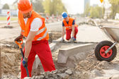 Builders and paving — Stock Photo