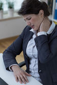 Overworked businesswoman suffer from pain — Stock fotografie