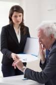Woman handing CV to tired boss — Stock Photo