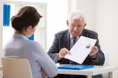 Boss  Discussing applicant's CV — Stock Photo