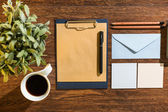Notes and black coffee — Stock Photo