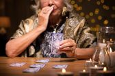 Fortune teller reading tarot card — Stock Photo
