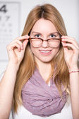 Woman at opticians office — Stock Photo