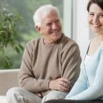 Smiling grandpa and caring granddaughter — Stock Photo #78175326