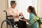 Caregiver helping old female — Stock Photo