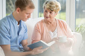 Older woman spending time with young man — Stock Photo