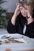 Woman looking at family souvenirs — Stock Photo