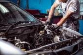 Mechanic maintaining car engine — Stock Photo