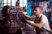 Car technician maintaining automotive engine — Stock Photo
