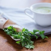 Parsley and white cup — Stock Photo