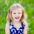 Pretty laughing little girl with long blond curly hair — Stock Photo #61670171