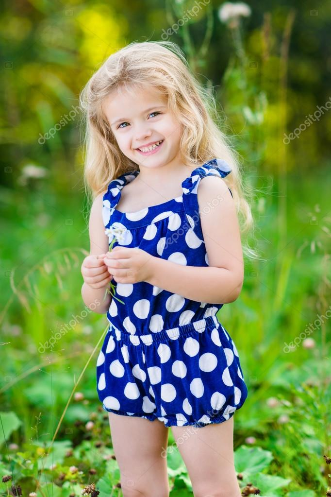 Beautiful Smiling Little Girl With Long Blond Curly Hair