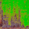 Rusty painted metal with cracked paint. Orange, brown and green colors. Texture color grunge background — Stock Photo #72720013