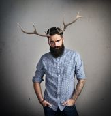 Brutal bearded man with horns — Stock Photo