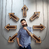 Thoughtful  man and lighting arrows — 图库照片