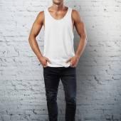 Man wearing white sleeveless shirt — Stock Photo