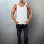 Man wearing white sleeveless shirt — Stock Photo