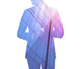 Double exposure of city and businessman — Stock Photo