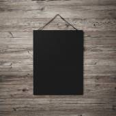 Black blank poster hanging on leather belt — Stock Photo