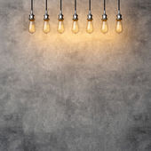 Decorative vintage lightbulbs with concrete background — Stockfoto