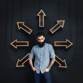 Bearded man and lighting arrows on a wall — Stock Photo
