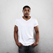 Young man wearing white blank t-shirt — Stock Photo