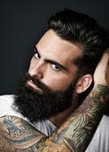 Portrait of a tattooed bearded man — Stock Photo