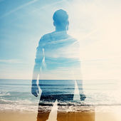 Double exposure of traveler and sea — Stock Photo