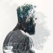 Double exposure of bearded guy and forest — Stock Photo