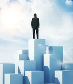 Man standing on highest cube — Stock Photo