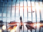 Businessman at airport near the window — Stock Photo