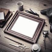 Tools of a barber with picture frame — Stock Photo
