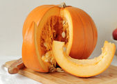 Slicing pumpkin for soup or pie — Stock Photo