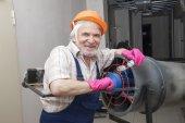 Man fixing industrial heater — Stock Photo