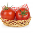 Two ripe juicy tomatoes in a basket — Stock Photo #54519789