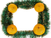 Frame of yellow tangerine on green garland — Stockfoto