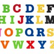 Alphabet written in multicolored plastic kids letters — Stock Photo #59584235