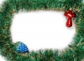 Frame of green Christmas garland with Christmas toys — Fotografia Stock