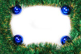 Frame of green Christmas garland with blue balls — Стоковое фото