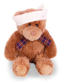 Teddy bear with bandaged head — Stock Photo