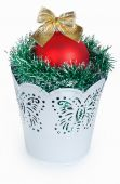 Golden Christmas red ball and the green garland in decorative wh — Stock Photo