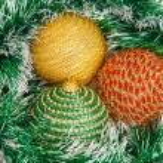 Three Christmas balls on green garland — 图库照片 #59847383