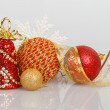 Three Christmas balls with red bell and white snowflake — Stock Photo #60453917