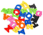 Alphabet written in multicolored plastic kids letters — Stock Photo