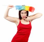 Sexy woman in red shirt with whisk for house dust — Stock Photo