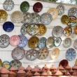 Colorful faience pottery dishes and tajines on display in Morocc — Stock Photo #67381111