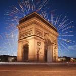 Arc de Triomphe, Paris lit up by Fireworks — Stock Photo #54919643