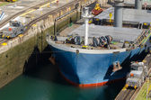 Oil tanker, assisted by tugboats in Panama Canal  — Stock Photo