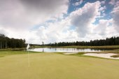 Golf course and white clouds — Stock Photo